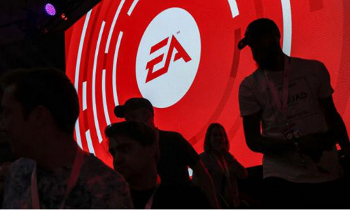 The Electronics Arts logo and attendees at an EA Play event.